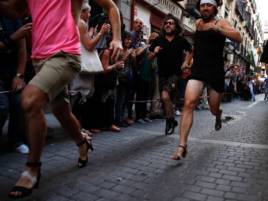 Contestants take part in the annual race on high heels during Gay Pride celebrations in the quarter of Chueca in Madrid