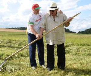 Belarus' President Alexander Lukashenko (L) teaches French actor Gerard Depardieu how to scythe at his official residence Ozerny, outside Minsk, on July 22, 2015. AFP PHOTO / BELTA / ANDREY STASEVICHANDREY STASEVICH/AFP/Getty Images